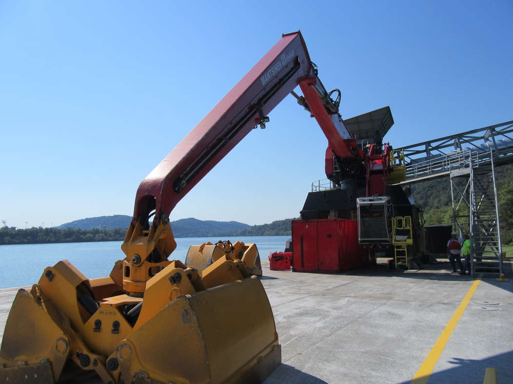The Mantsinen 120 HybriLift material handler equipped with a 4 cu. yd. bucket was the main attraction at the ribbon-cutting ceremony.