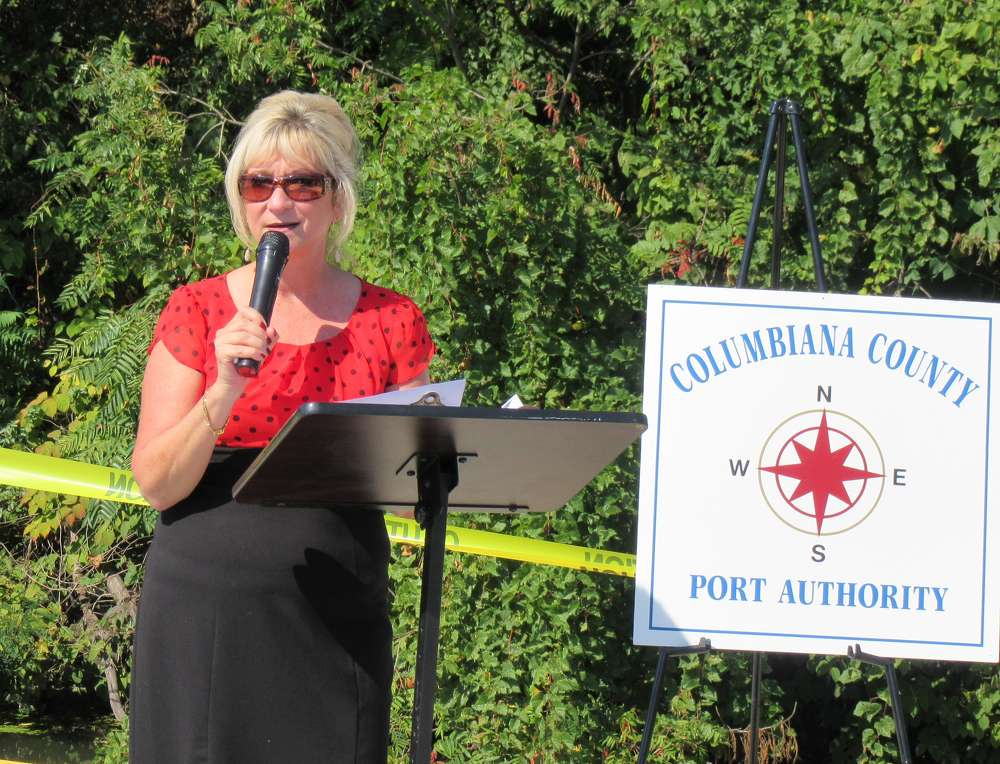 Penny Traina, CEO and executive director of Columbiana County port authority, makes opening comments at the ribbon-cutting ceremony.