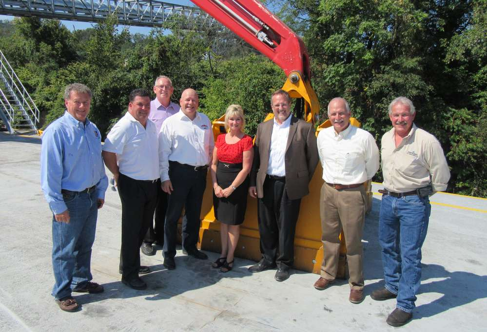 (L-R): George Seanor, Ruhlin Corporation; Ralph Binder of Ohio CAT; Larry Heck of Pier 48 Stevedoring LLC; Asko Kinnunen of Mantsinen; Penny Traina, CEO and executive director of Columbiana County Port Authority; Ken Taylor and Bob Stadvec both of Ohio CAT; and Ron Tschantz, Imperial Technologies, were on hand for the ribbon-cutting ceremony.