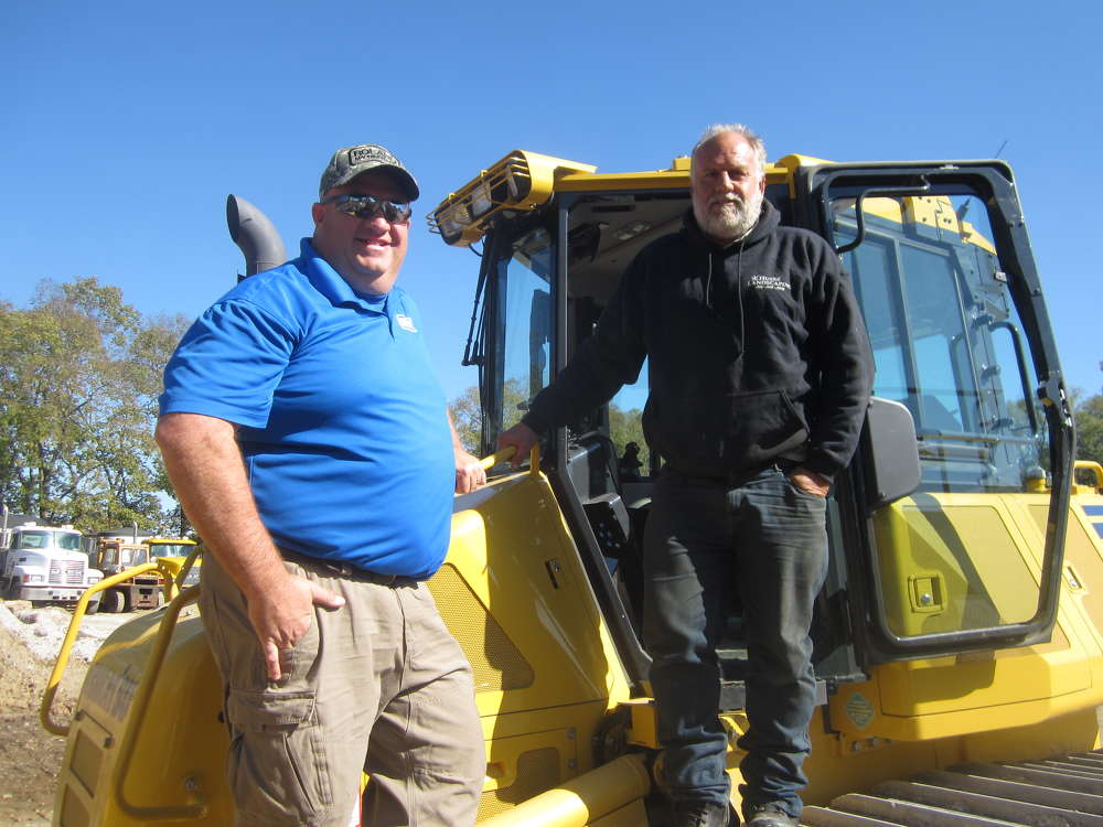 Tom Elam (L), Roland Machinery Co., speaks with Doug Huser of Huser Landscaping about the Komatsu  D61 Pxi dozer equipped with Intelligent Machine Control.