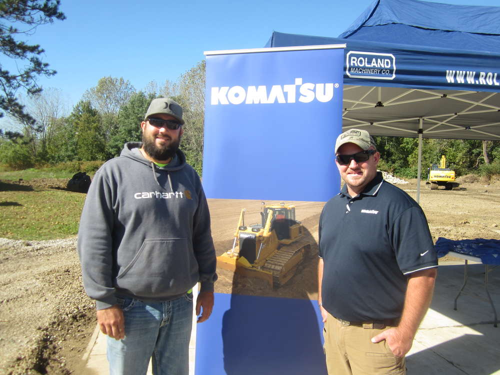 Josh Runyon (L), River City Demolition, and Kyle McDowell, Roland Machinery, discuss Komatsu equipment in the demo area.
