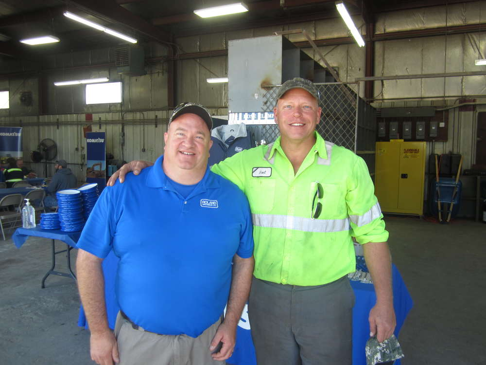 Tom Elam (L), Roland Machinery Co., gives Bret Saal of Otto Baum Contractors a tour of the shop area of the Peoria facility.