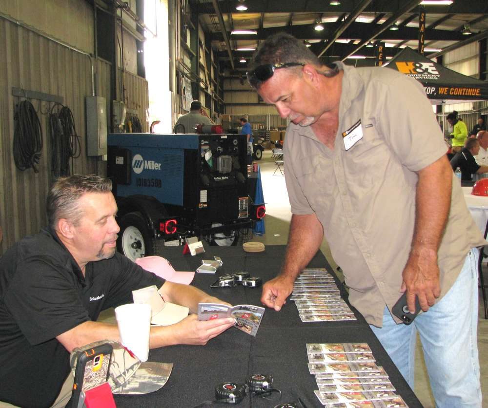 Lane Scroggins (L) of Solesbee's Equipment and Attachments, Winston, Ga., talks about his products with Tim Pedersen of Centerpointe Construction, Garner, N.C.