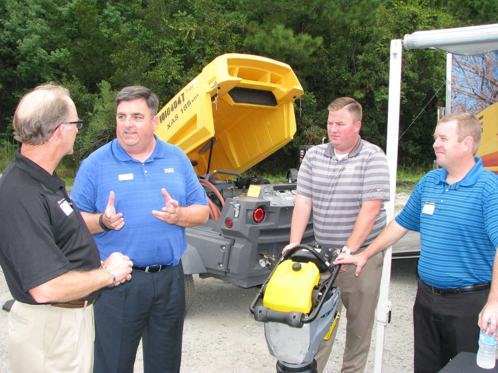(L-R): Rick Glenn, H&E Equipment Services, talks with his Atlas Copco rental managers, including Steve Nelson, Justin McKenzey and Rob Repasz.