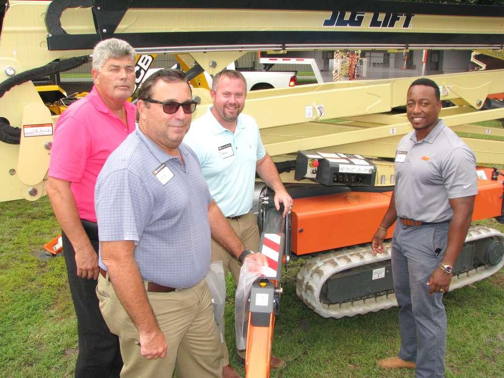 (L-R): Harold Adams, Lyle Miller and Dean Strandburg, all of Hunt Construction, Indianapolis, Ind., talk with Leonard Love,  JLG representative, Charlotte, N.C.