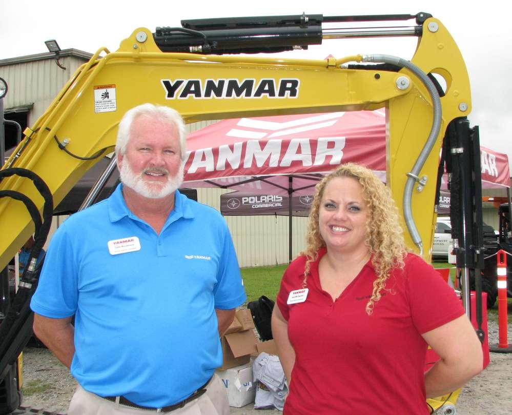 Dale McLemore (L) and Jennifer Garrett, Yanmar, promote