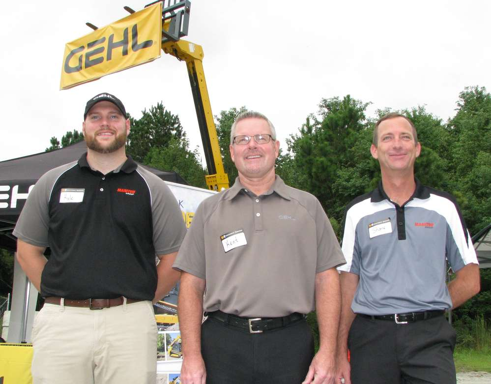 (L-R): Kyle Robinson, Kent Marshall and Shane Sirmons of the Manitou Group attend the grand opening.
