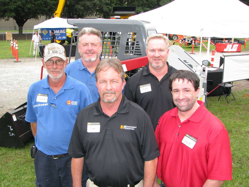 (L-R): Lonnie Bradham and Pete Brown, both of Gregory Electric Company, Columbia, S.C.; Joe Sheffield and Matt Martin, both of H&E, Savannah, Ga.; and Steve DePriest, Takeuchi, Pendergrass, Ga., discuss the Takeuchi product line.