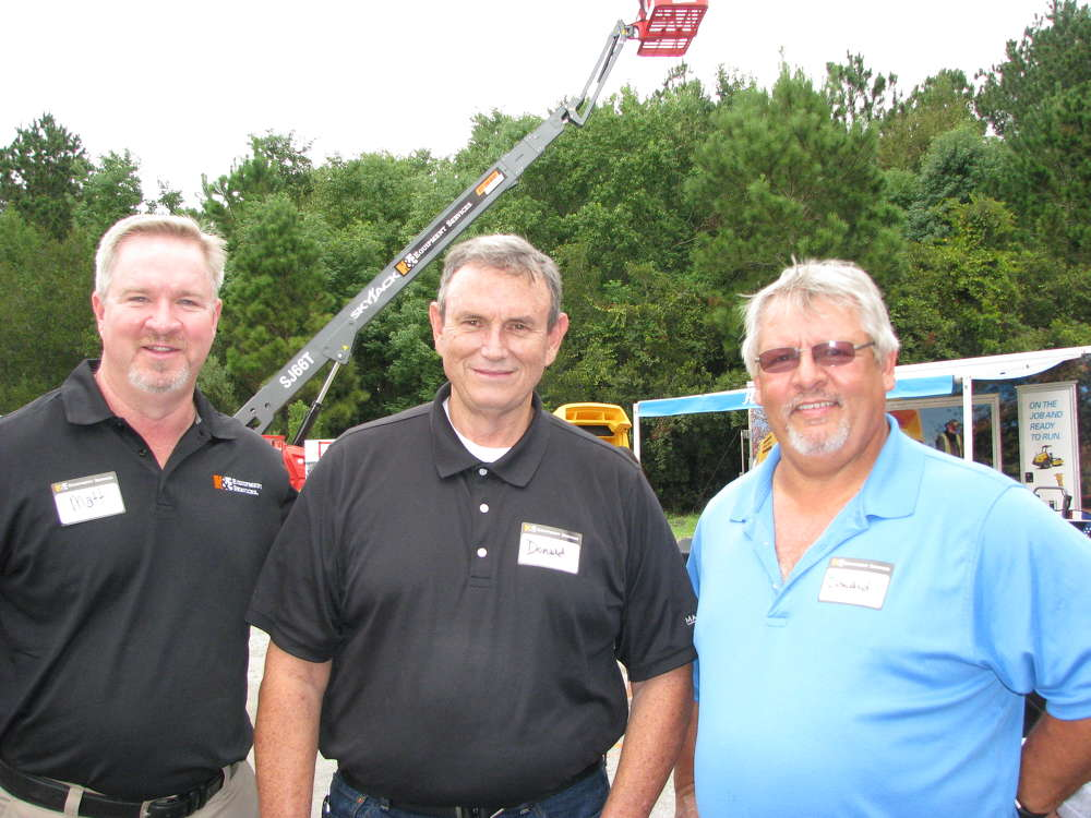 (L-R): Matt Martin, H&E Equipment Services, welcomes Donald Stephens and Donald Labean, both of Master Steel, Hardeeville, S.C., to the event.