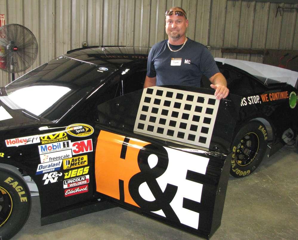 A NASCAR race car with a door? Yep. Todd Westbrooks, Morrow Construction, Stockbridge, Ga., enjoys his run in the race car simulator.