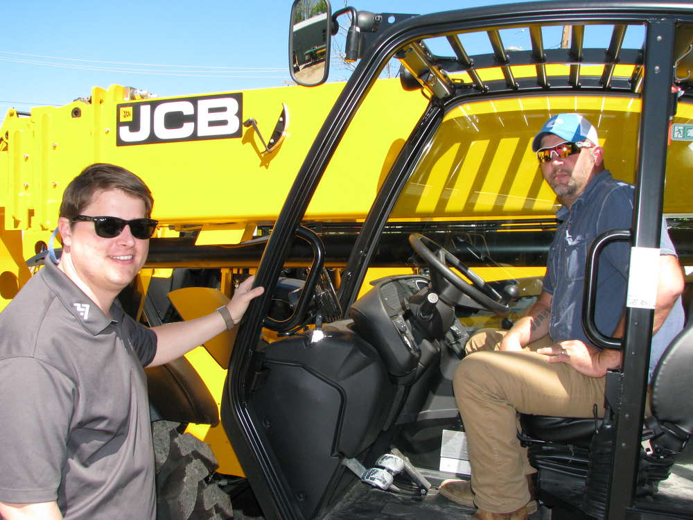 Neal Adams (L) and Charles Webster, both of Adams Masonry, Chattanooga, Tenn., get a closer look at this JCB 510-56 telescopic forklift.