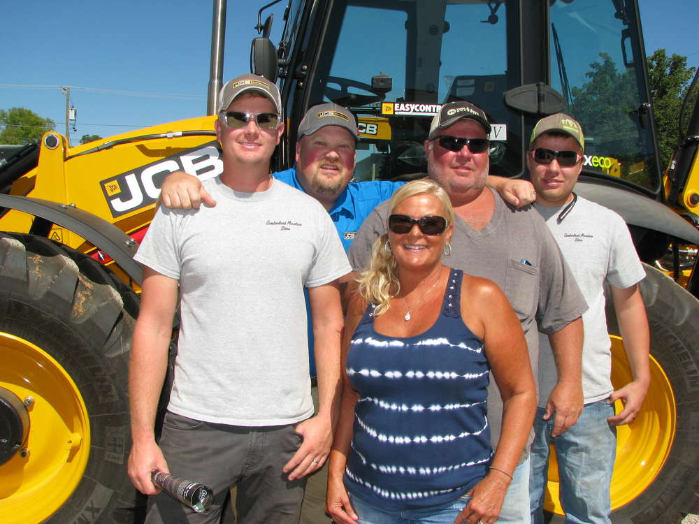 Nick Jones (second from L), JCB of Chattanooga sales manager, gives a warm welcome to his customers (L-R) Jason Hale, Robin York, Avery York and Andy York, all of York & Sons Quarries, Crossville, Tenn.
