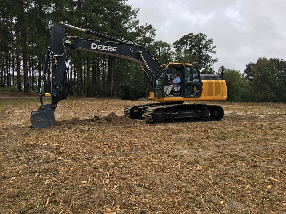 Contractors test out the John Deere 210G excavator equipped with the Topcon x53 excavator system from Benchmark Tool & Supply.