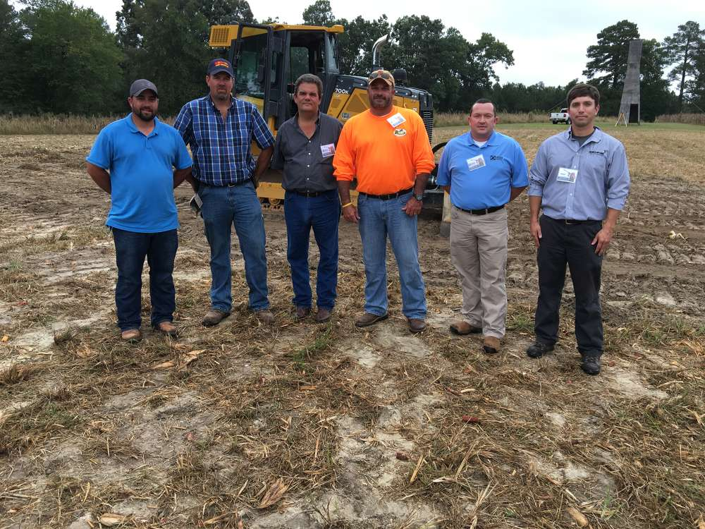 (L-R): Justin Moorefield, Steven Perkins and Bryan Coley, all of Ace Avant in Archdale, N.C.; Eldon Burgiss & Mookie Leftwich, both of James River Equipment; and Mike Gaillard of Benchmark Tool & Supply discuss the John Deere 700K SmartGrade crawler dozer.