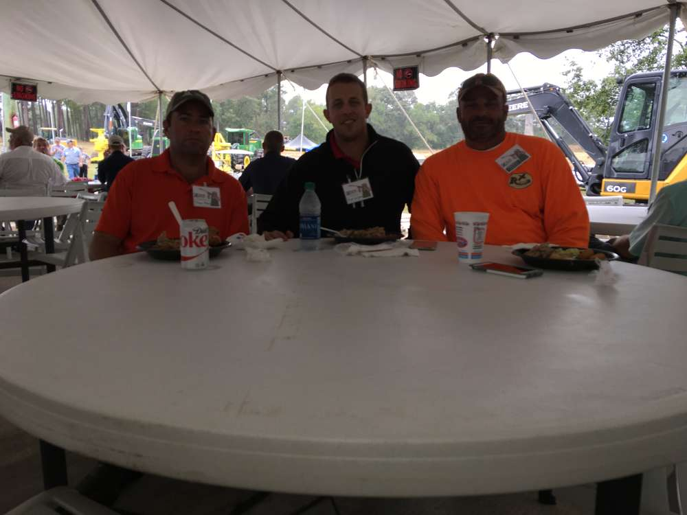 (L-R):?Thomas Maben and Matt Waligora, both of Martin Marietta, have lunch with Eldon Burgiss of James River Equipment.