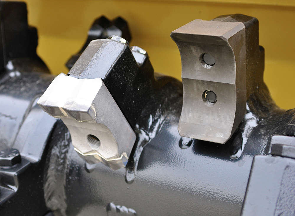Rayco's 2-bolt mulcher teeth are 2-sided, to provide twice the useful life of competitive teeth.