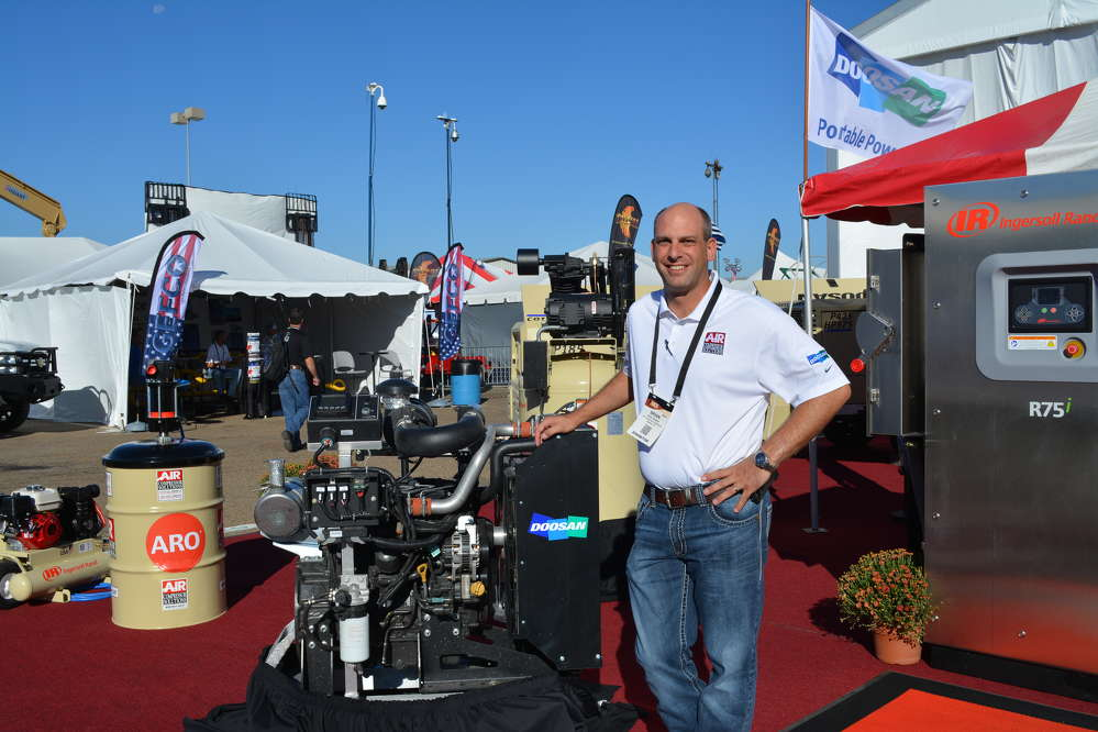Brian Stubbs, general manager of Air Compressor Solutions of Odessa, Texas, displays his line of Doosan Portable Power equipment.