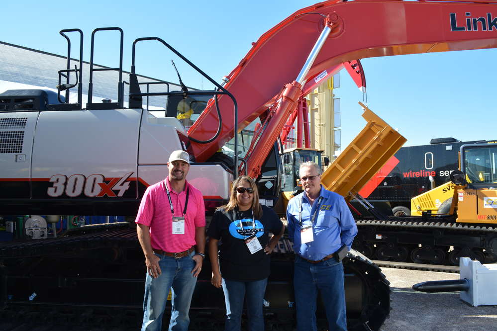 (L-R): TJ Sparks, Vanity Rojas and Vernon Bruton of Cisco Equipment are eager to talk about Link-Belt's 300x4 excavator.