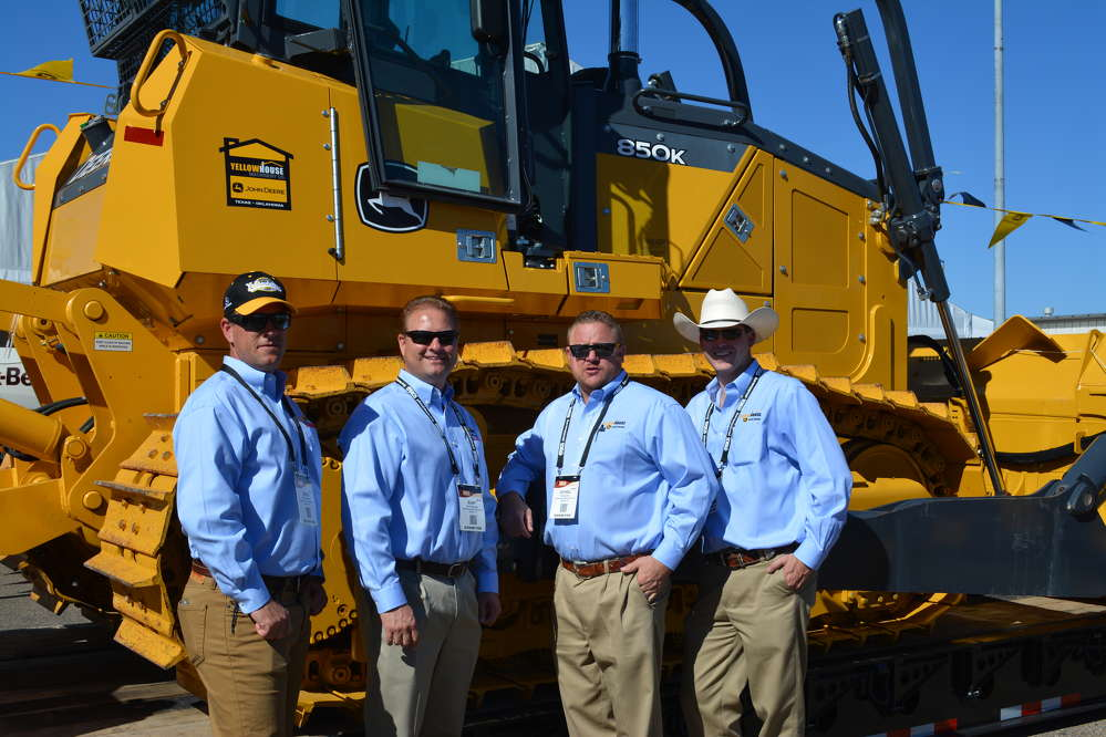 Yellowhouse Machinery Co. displayed the full line of John Deere construction equipment, including the 850K dozer. (L-R) are Brad Downing, Burt Stringer, Eric Schiel and Reid Layton, all of the Yellowhouse Odessa branch.