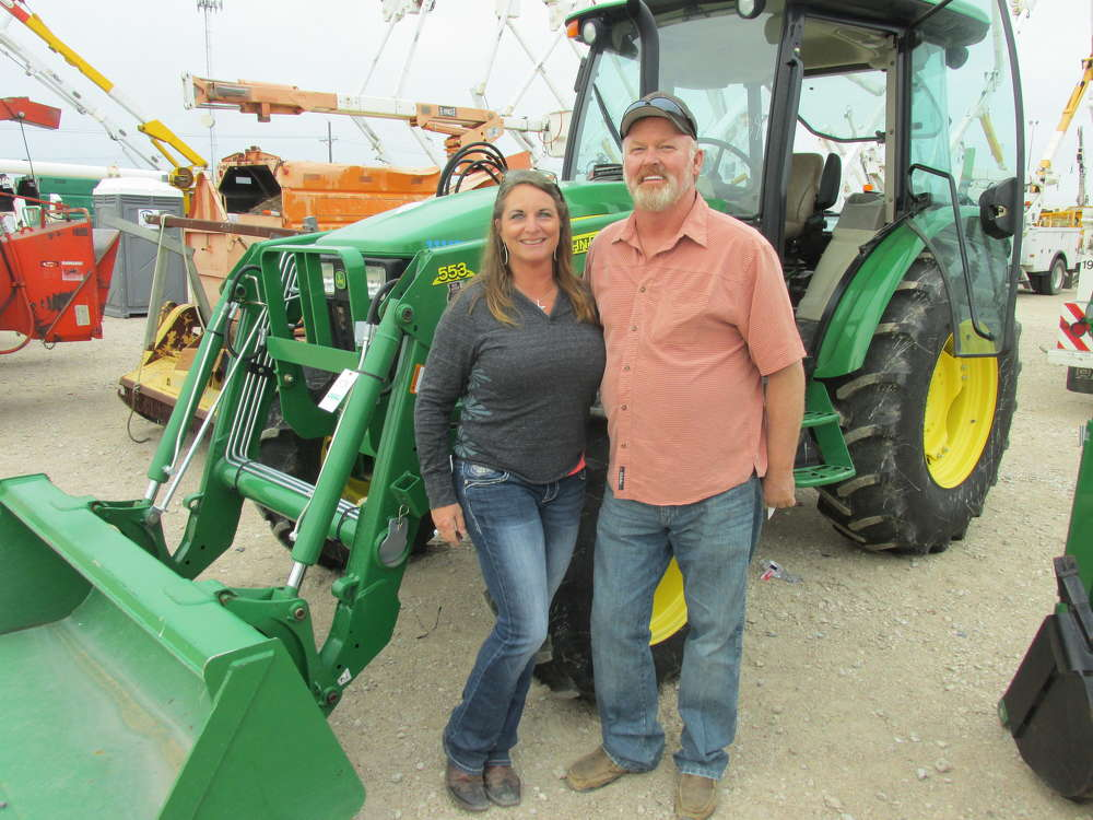 Karen (L) and James Marrow of M-LINE Cable, Georgetown, Texas, just bought 25 acres of their own and this John Deere 553 loader will do what they need on the new property.