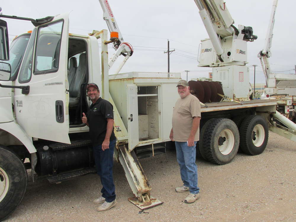 John Fielder (L) and Lawrence Kinney plan to bid on this Altec pole placer for their new venture, J & L Communications in Granbury, Texas.