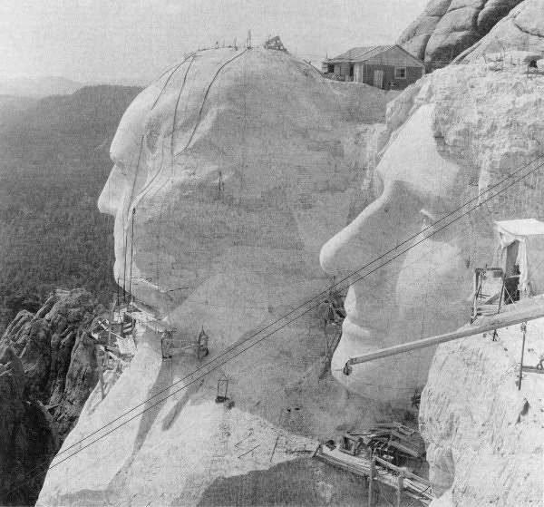The faces of Washington and Jefferson with the pulleys used to raise and lower the work platforms for men and equipment visible, c. 1930s. Image courtesy of Bill Groethe.