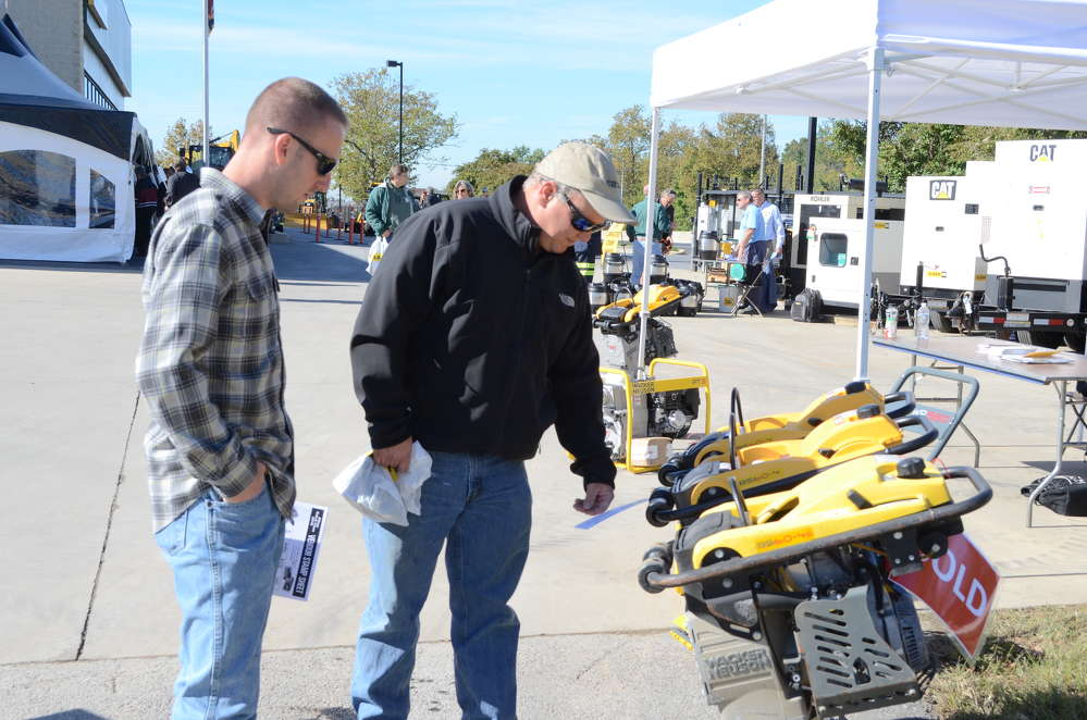Spencer Martin (L) of Clearing Concepts in Glenwood, Md., and Walter Dustin of Crimco in Howard County, Md., check out some Wacker Neuson rammers.