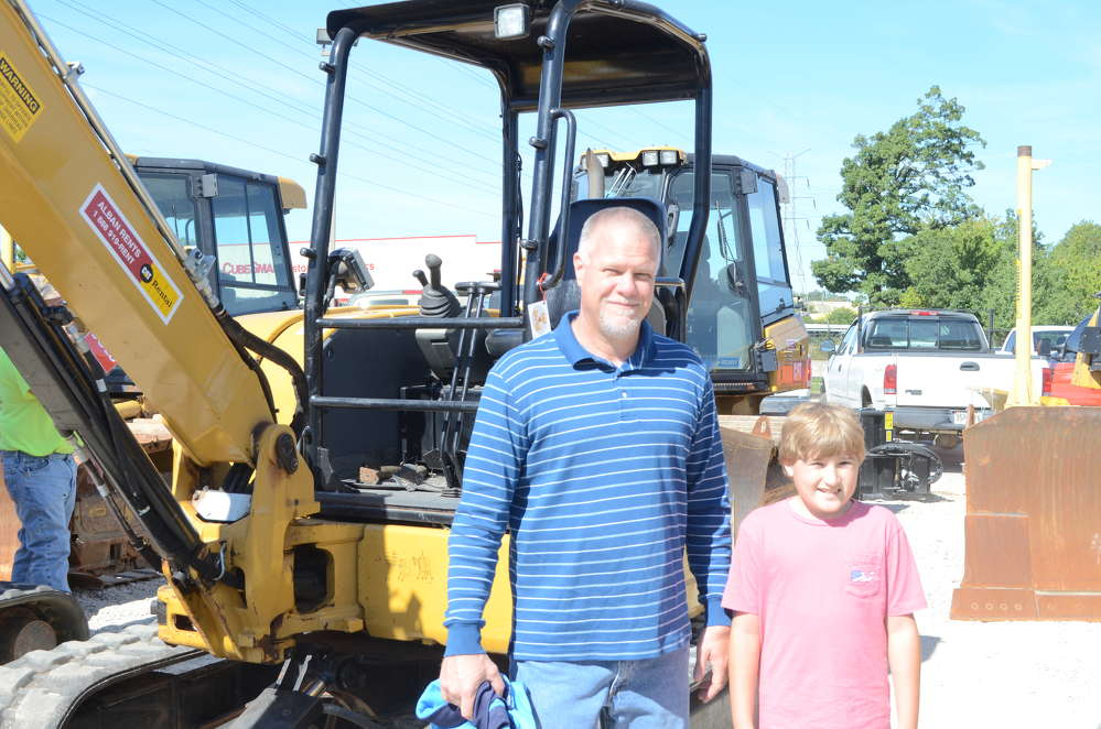 Rick Grambo, vice president of sales and engineering, Pritchard Brown, Baltimore, Md., and Ethan Grambo are looking for some good deals on Cat equipment.