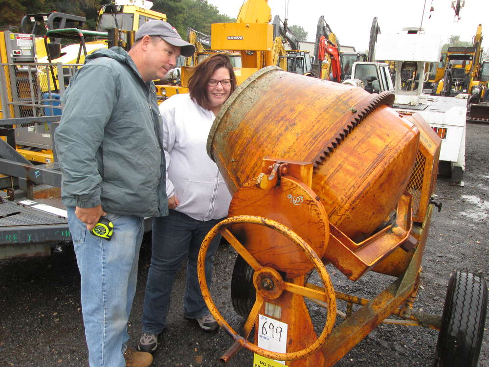 Robert Lodge and Cynthia Eisnor of Lodge Earth Works of Windsor, Conn., look at a cement mixer, which they considered for purchase.