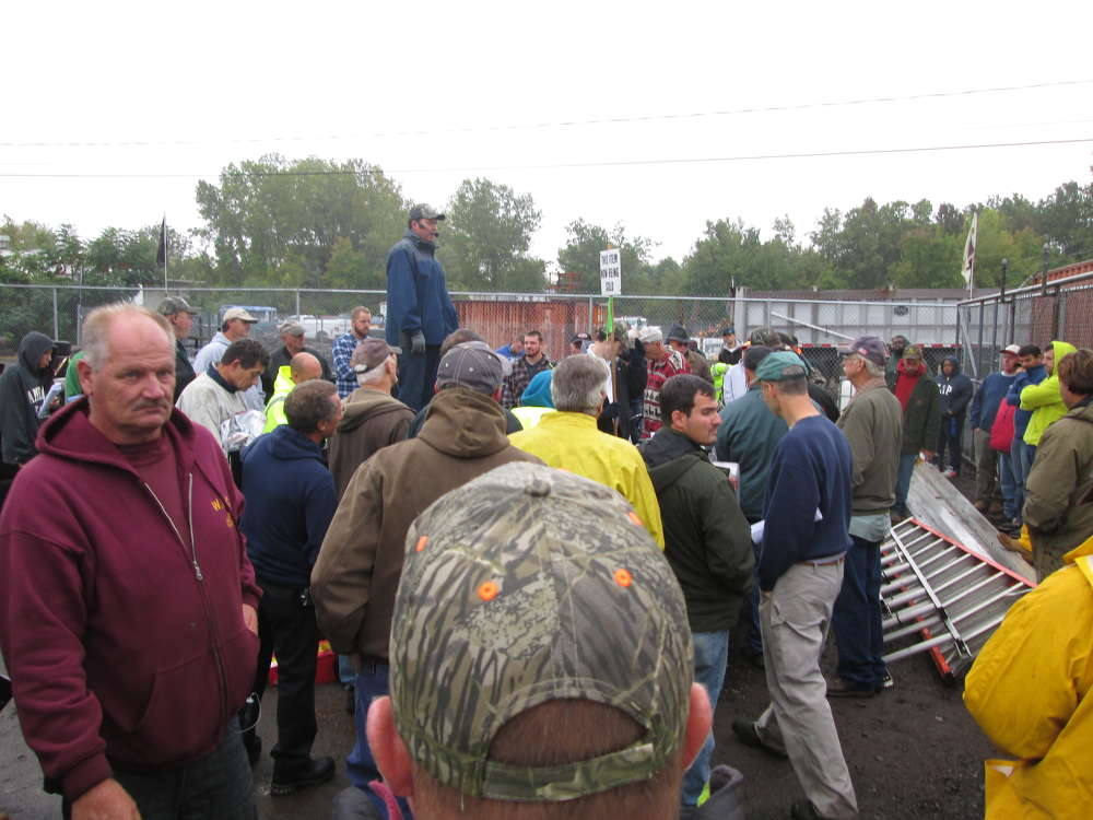 Not the grayest of skies, nor the muddiest of fields, could dampen the pitch at The Sales Auction Company massive public equipment auction.