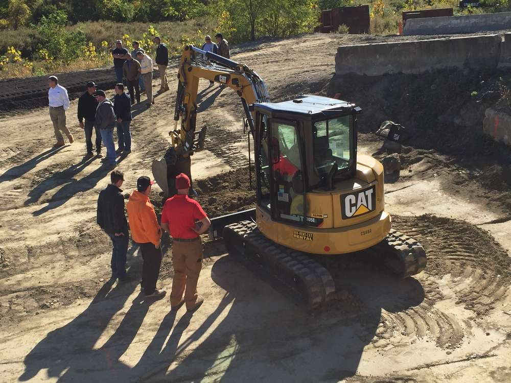 Guests receive instruction while operating this Cat 305E mini-excavator.