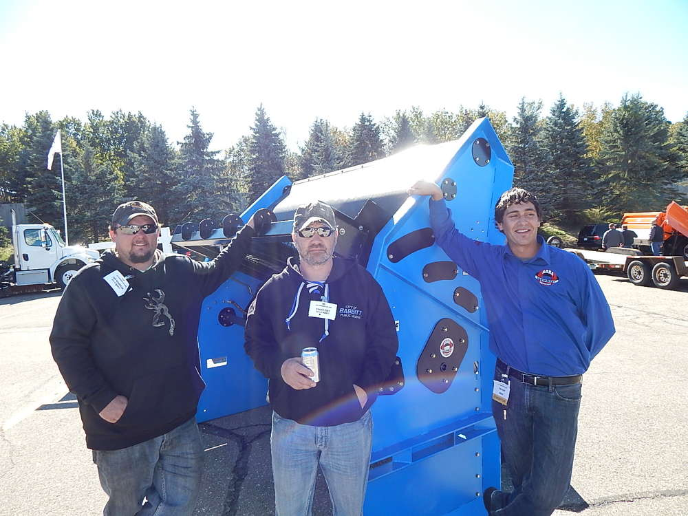 (L-R): Tony Chamberlin, equipment operator, and Richard Posey, street supervisor, both of the city of Babbitt, Minn., talk to Rob Ophoven, Abra sales representative, about their Abra Model 78 vibratory soil screener that they purchased.