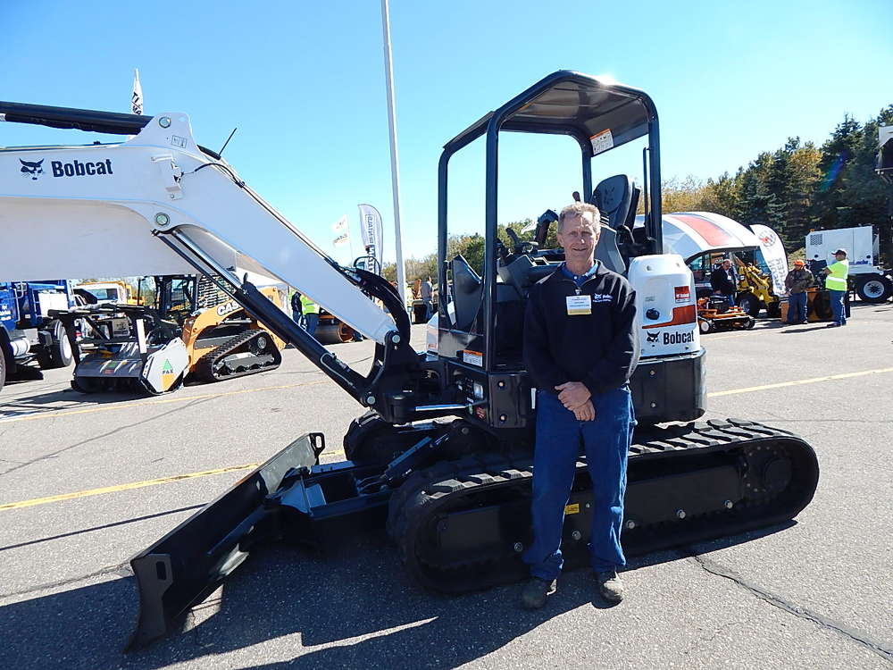 Mark Kunkel, sales specialist, Farm-Rite Equipment, St. Cloud, Minn., answers questions about this Bobcat E45 excavator.