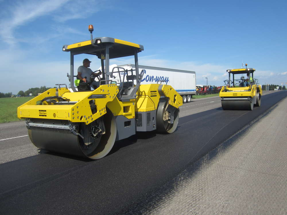 Walsh & Kelly Inc.'s operators use two Atlas Copco/Dynapac CC 5200 double drum rollers, equipped with Topcon's C-63 Intelligent Compaction system, on the state Road 19 in Elkhart County project.