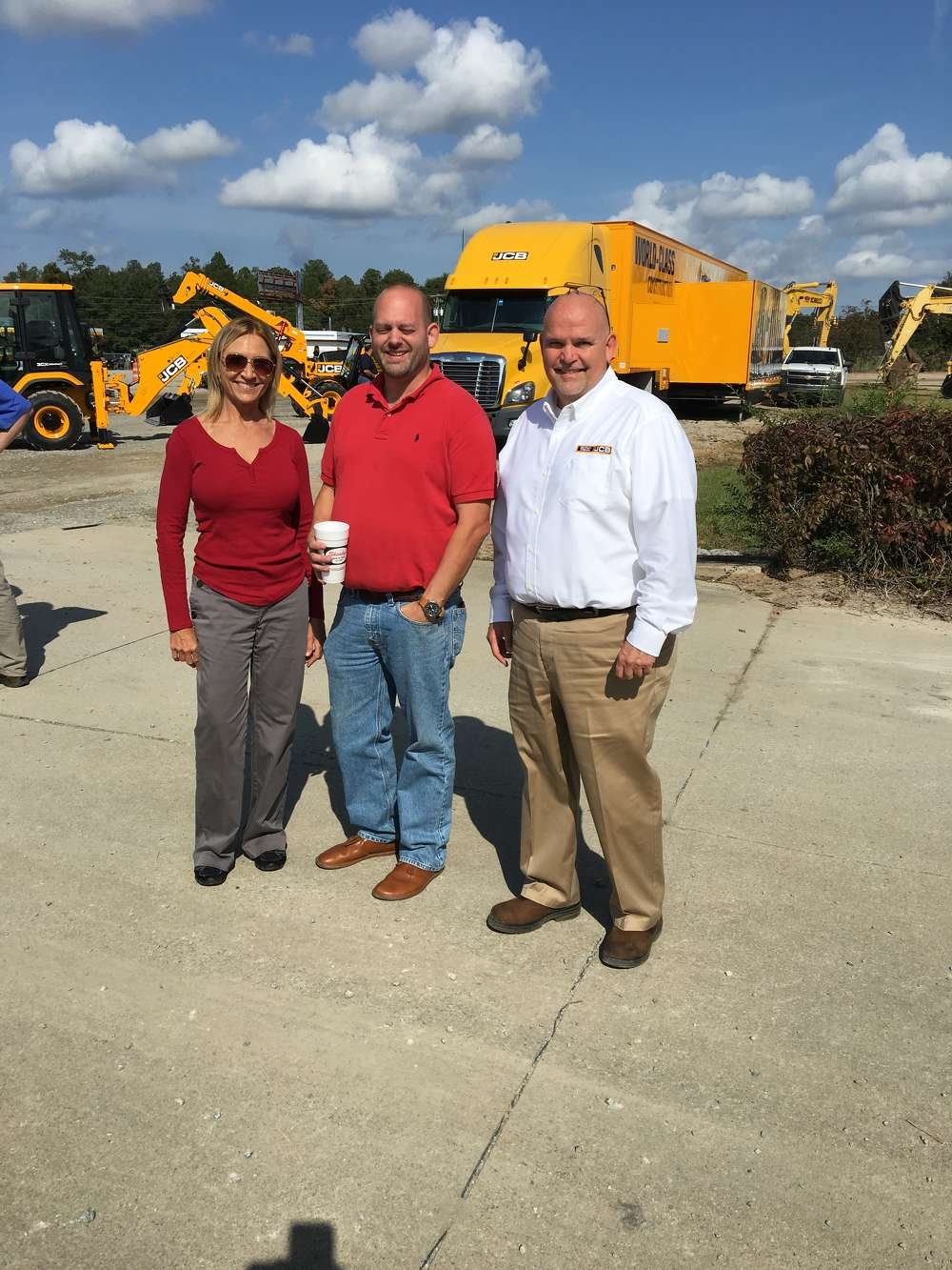 (L-R): Twilla Jeffcoat and Ted Thames, both of SCE&G, receive a warm welcome to the event by Cam Gabbard of Company Wrench.