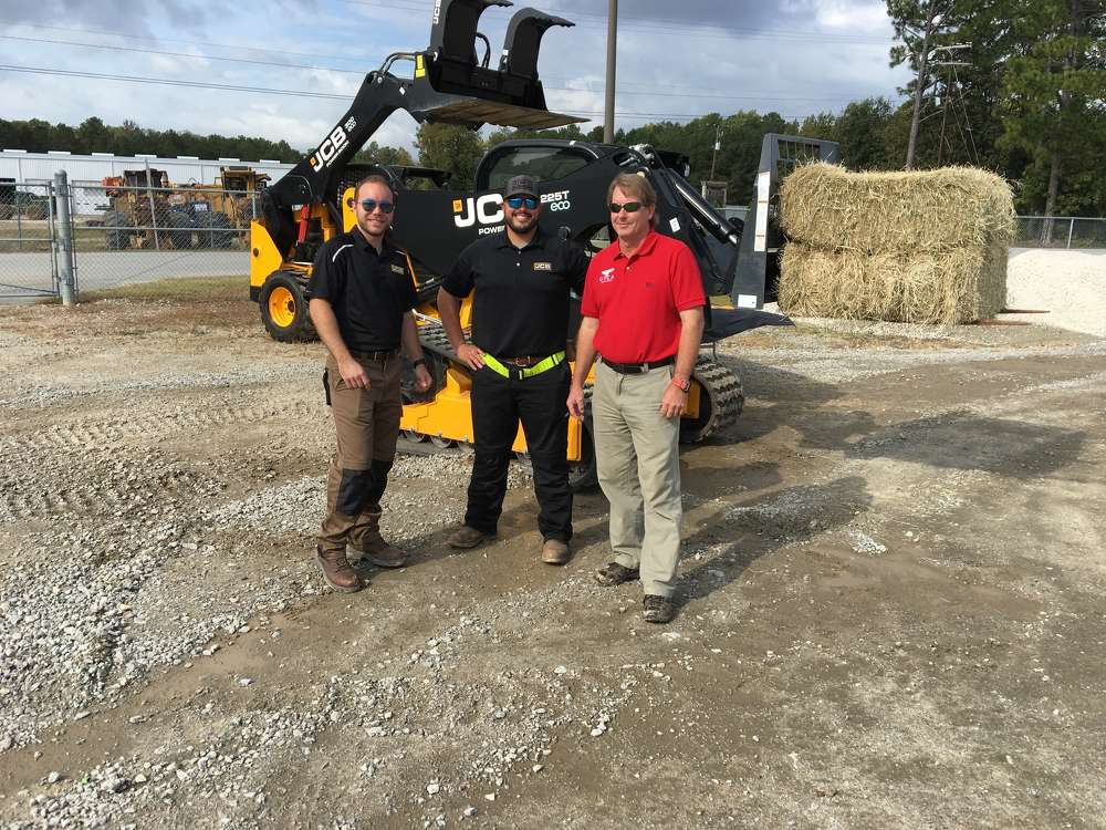 (L-R): Youssef Benjemaa and Randy Tinley, both of JCB, give operating tips to John Marc Hall of Lide Plumbing in Newberry, S.C.