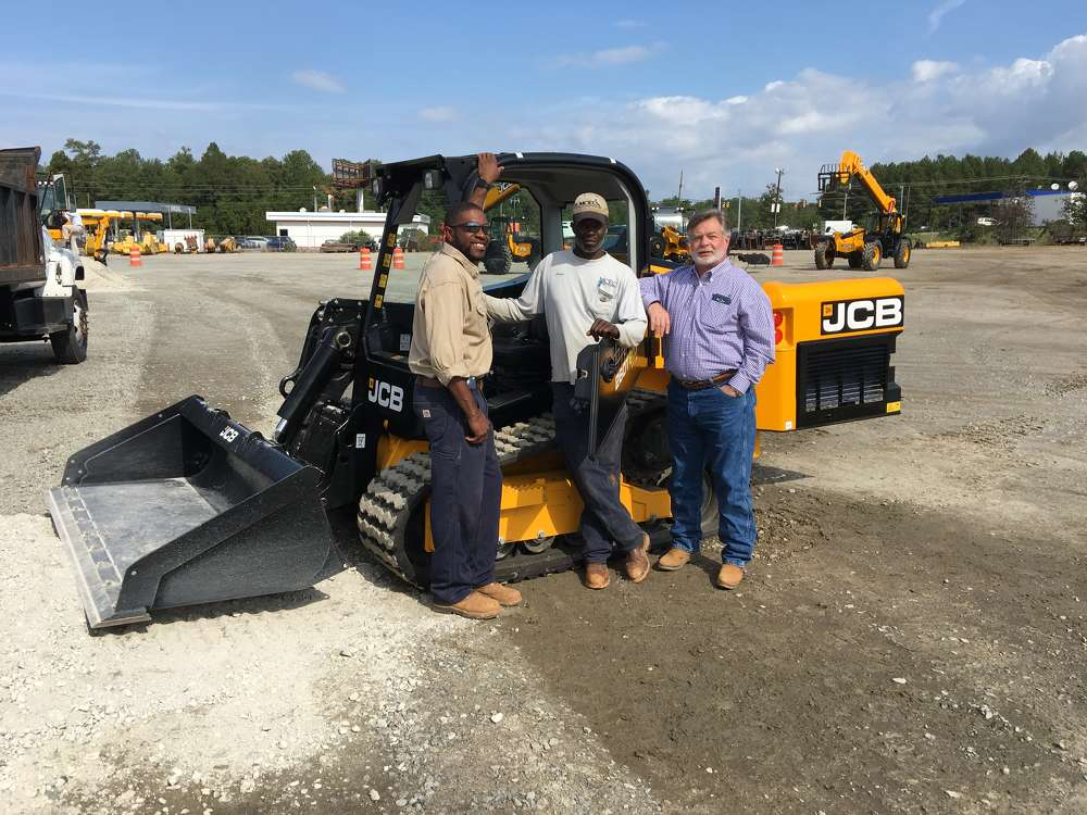 (L-R): Charlie Murphy, Julius Lybrand and Kenny Bickley, all of Mid-Carolina Electric Cooperative in Lexington, like the ease of access into the cab of the JCB compact track loaders.