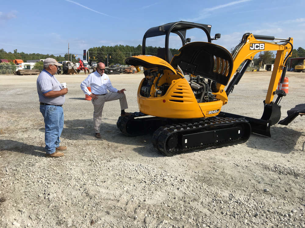 Billy Wall (R), Company Wrench, goes over the JCB 8040 ZTS excavator with Donald Taylor of Taylor Brothers in Columbia, S.C.