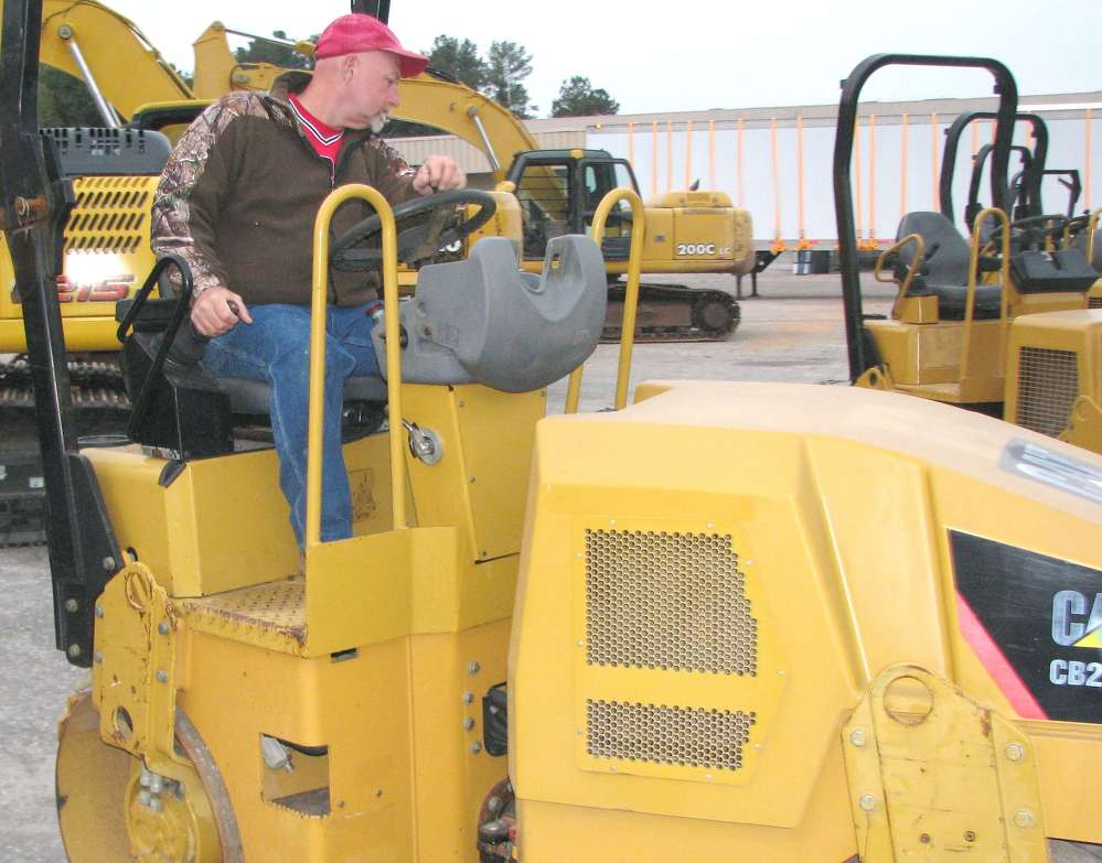 Scotty Garmon of SG Paving Contractors, Ball Ground, Ga., tests this Cat CB22 asphalt compactor.
