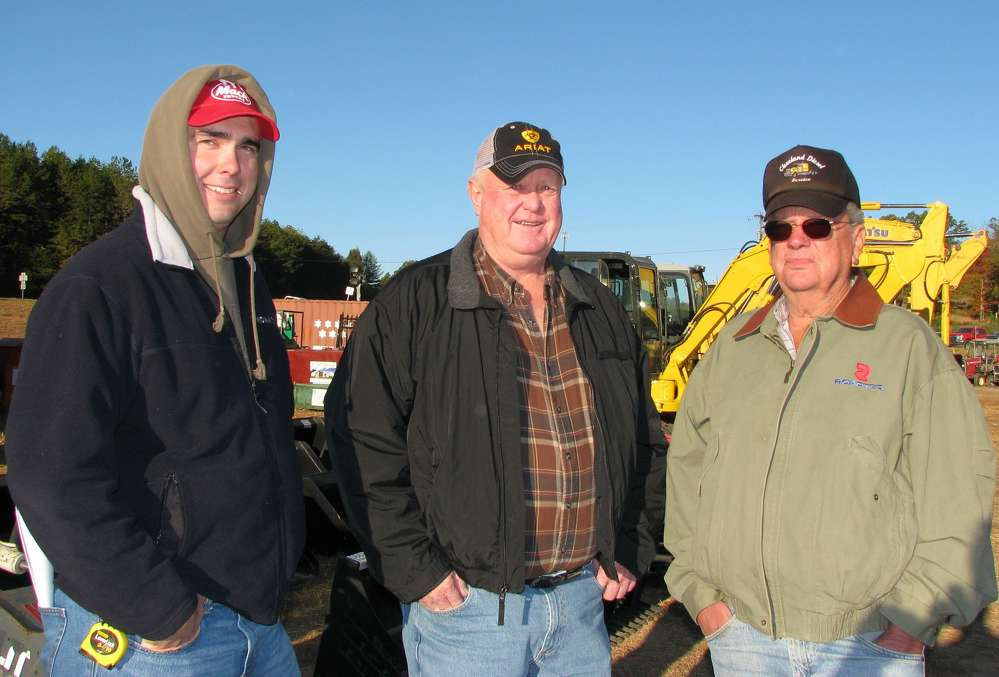 (L-R): Jeremy Adams and Gary Edwards, both of Stadco Development, Blairsville, Ga., and Bill Donaldson, Coldicz Paving, Blairsville, Ga., talk about construction and paving machines.