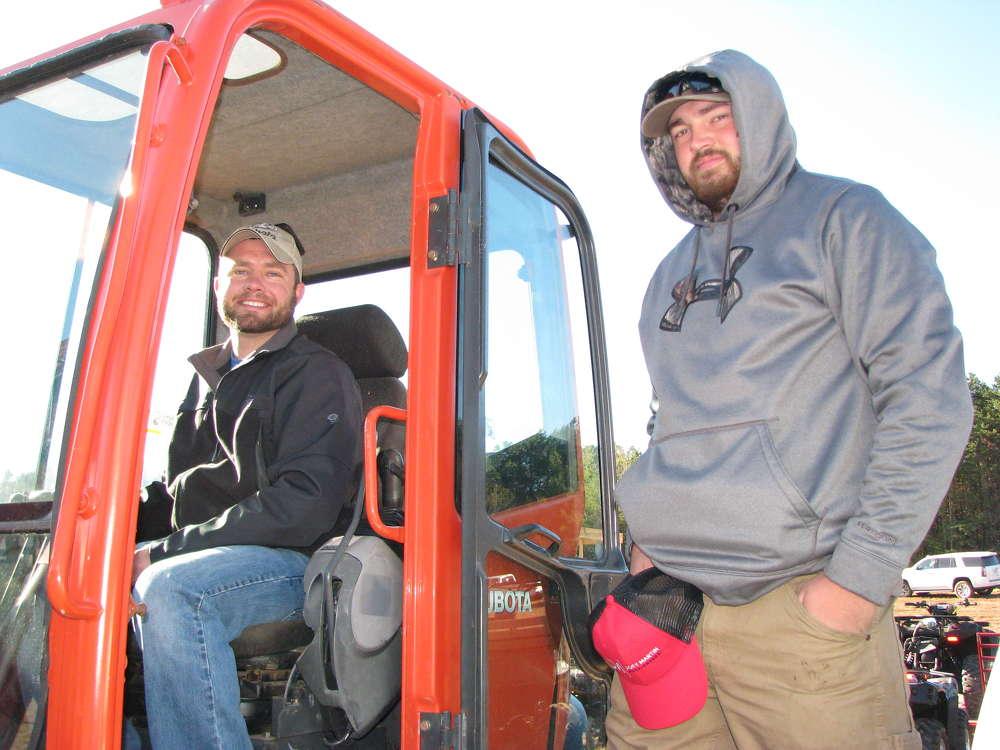 Blake Chastain (L) and Colton Stroud of WRC Masonry, Hiawassee, Ga., test this Kubota KX080-3 mini-excavator.