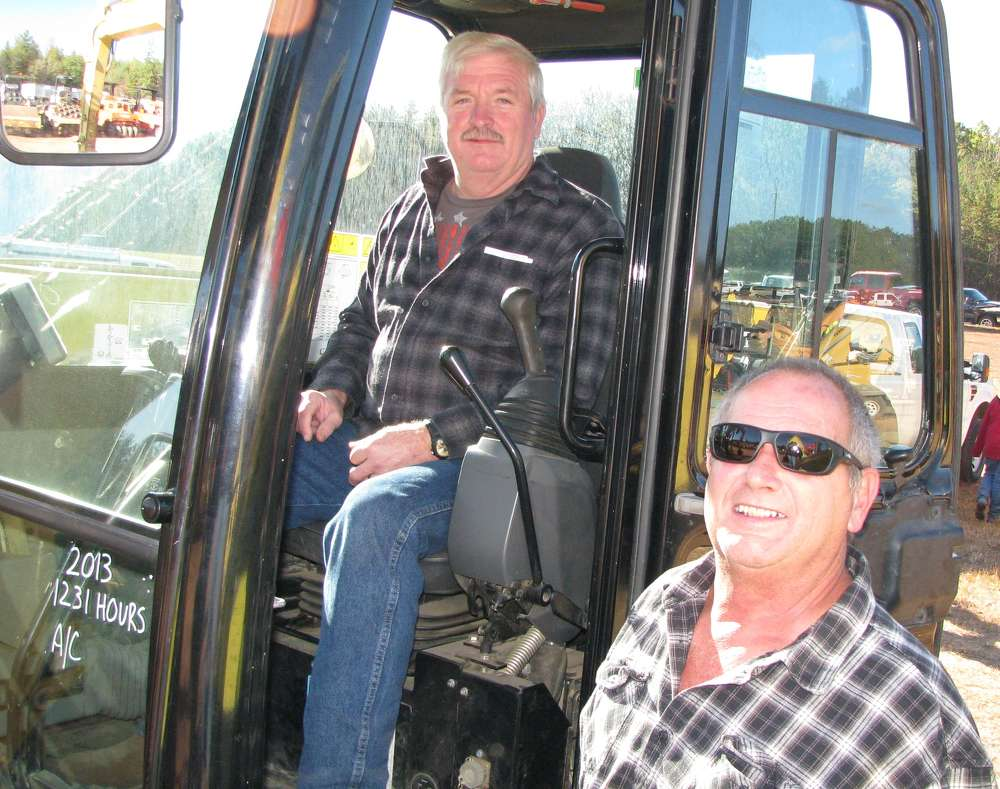 Ed Hawkins (L) and Terry Callihan of Chattahoochee Construction, Blue Ridge, Ga., show interest in this late-model Cat 308E2 CR with only 1,200 hours.