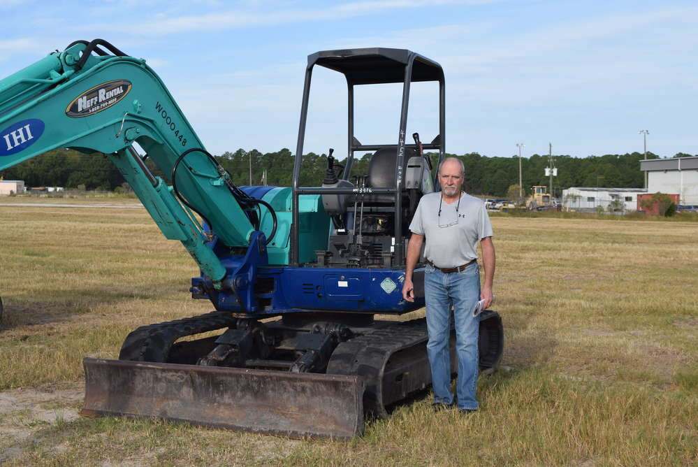 Roger McHugh, Brookside Equipment Sales, Phillipston, Mass., inspects this IHI 65NX excavator.