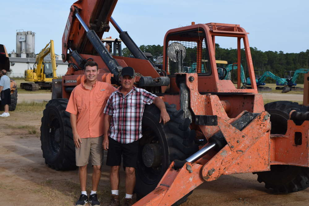 Chase (L) and Colin Kelley consider several machines, including this Lull 1044C54 Series II.