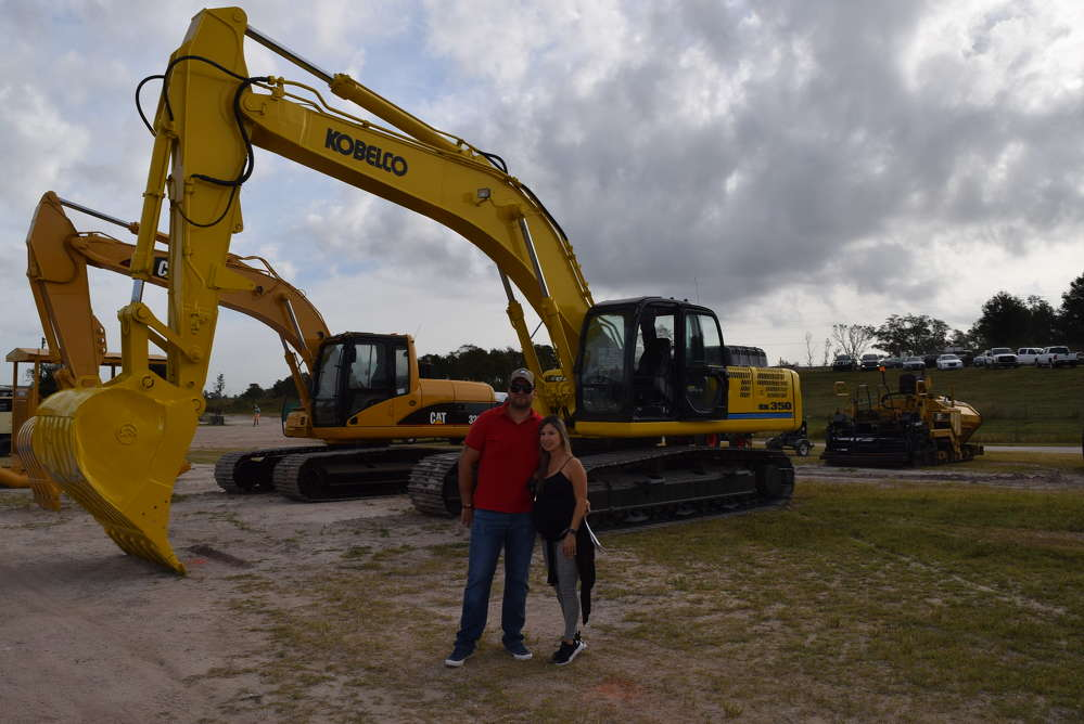 John and Monica Quintero, Quinlon Investments in Doral, Fla., inspect this Kobelco SK 350.