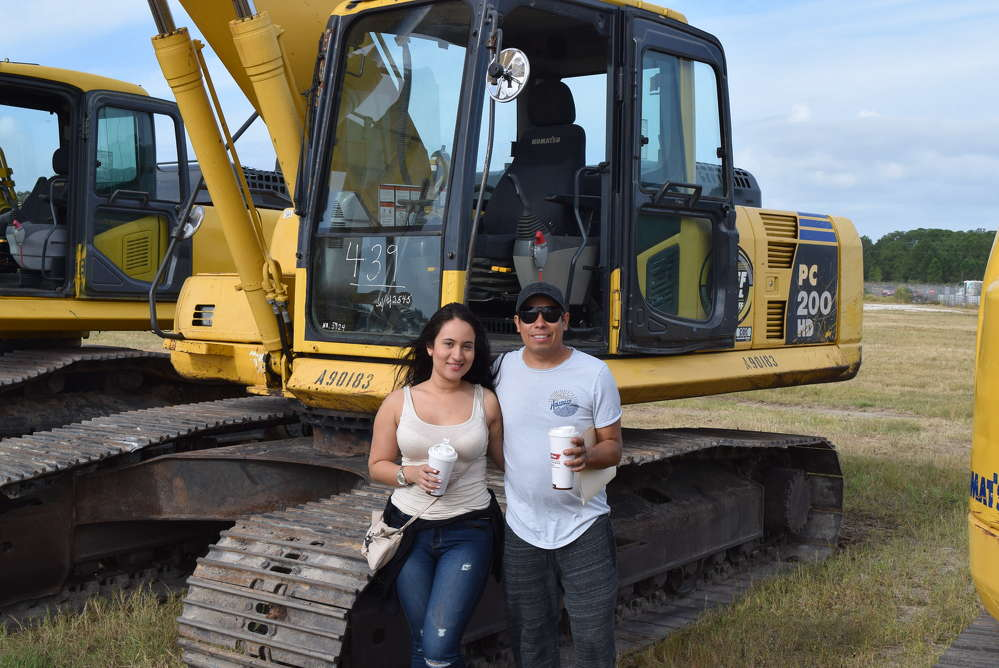 Katherine Rodriguez and Vincent Gomez of American Recycling in Tampa, Fla.,  test operate the Komatsu PC 200 HD.