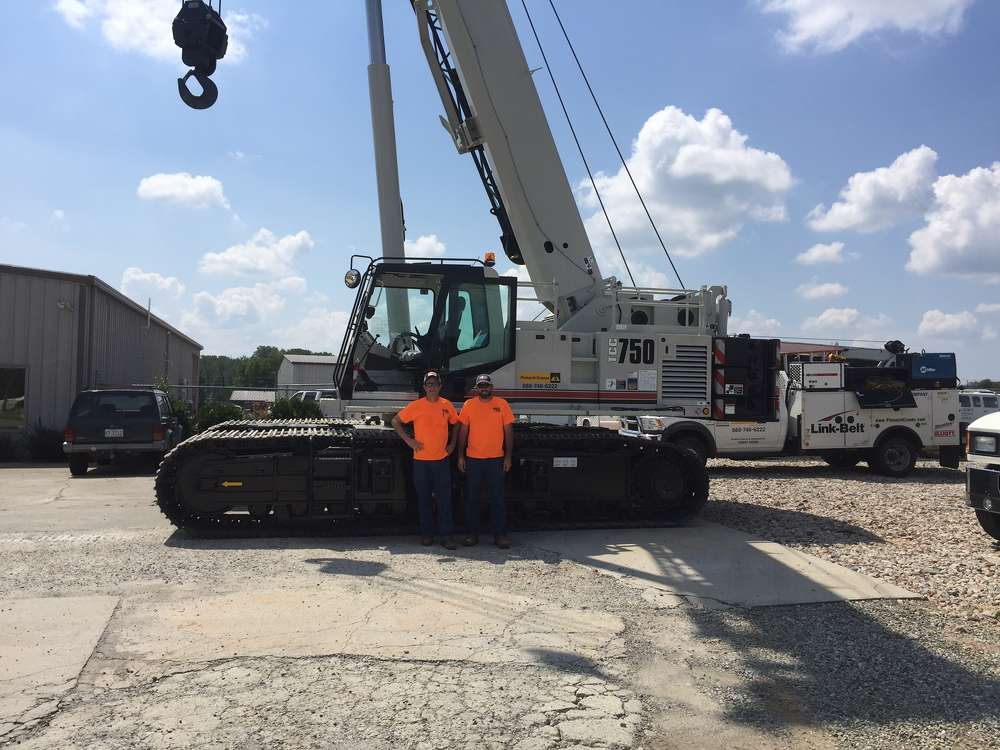 Bryan Mabe (L) and Josh Church stand with their new Link-Belt TCC-750.