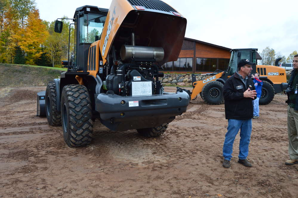 Robb Coenen, Case product promotion specialist, —    touts the Tier IV Final engine featuring Selective Catalytic Reduction (SCR) engine technology of the Case 621G wheel loader.