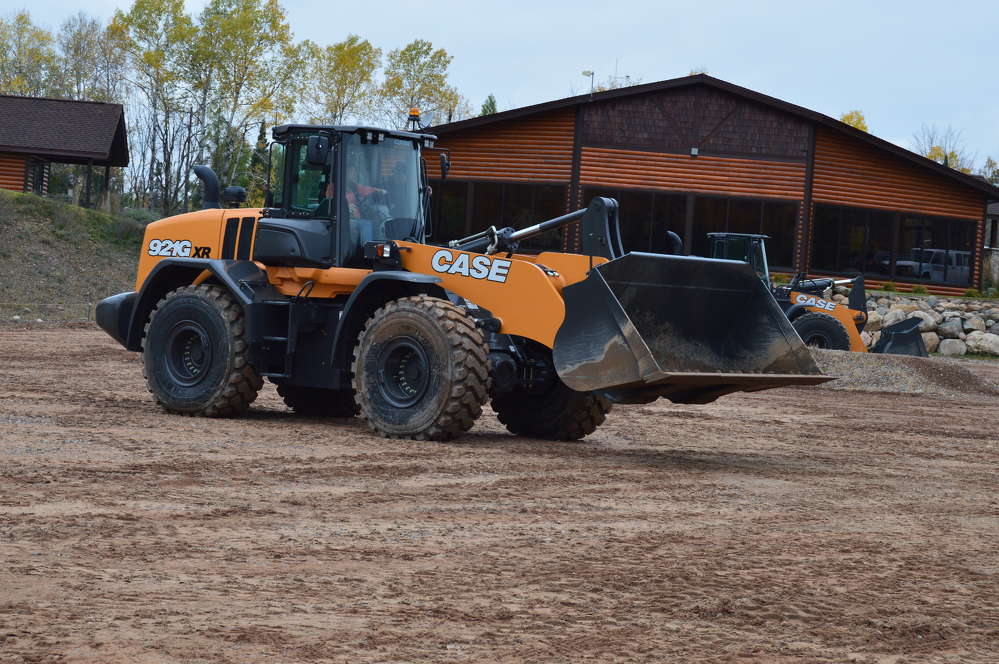 Guests play in the dirt and test the capabilities of this Case 921G wheel loader.