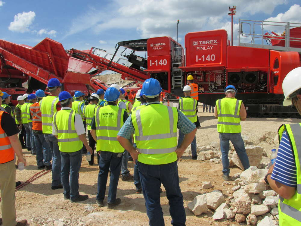 Crowds gather for the demonstration of the new I-140 impact crusher.